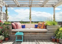 Flowring-plants-and-wooden-deck-transform-the-roof-into-a-beautiful-hangout-217x155