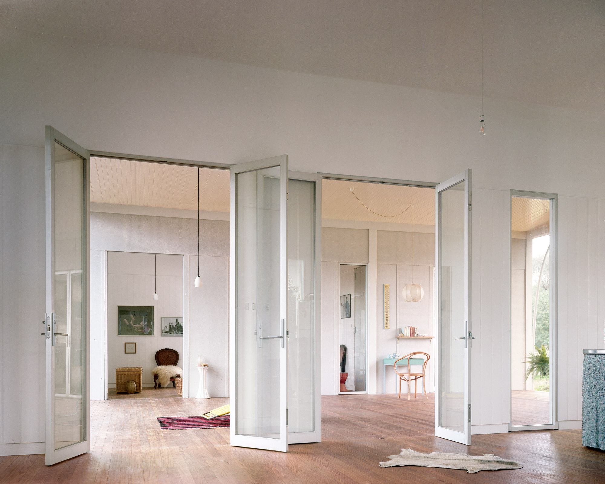 Framed glass doors connecting different rooms of the house