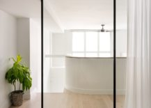 Glass-doors-with-minimal-black-frame-and-white-drapes-for-the-modern-bedroom-217x155