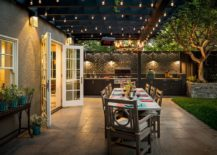 Gorgeous-Edison-bulbs-illuminate-the-lovelly-covered-patio-with-outdoor-kitchen-and-dining-217x155