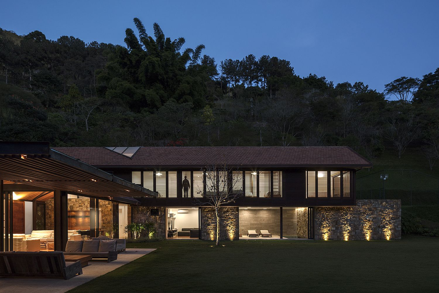 Gorgeous lighting and lovely natural landscape add to the beauty of the AS House