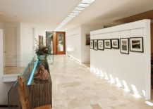 Grand-contemporary-entry-with-a-series-of-skylights-that-adds-to-the-majestic-visual-217x155