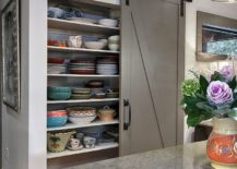 Gray-barn-style-sliding-door-for-the-transitional-kitchen-pantry-217x155