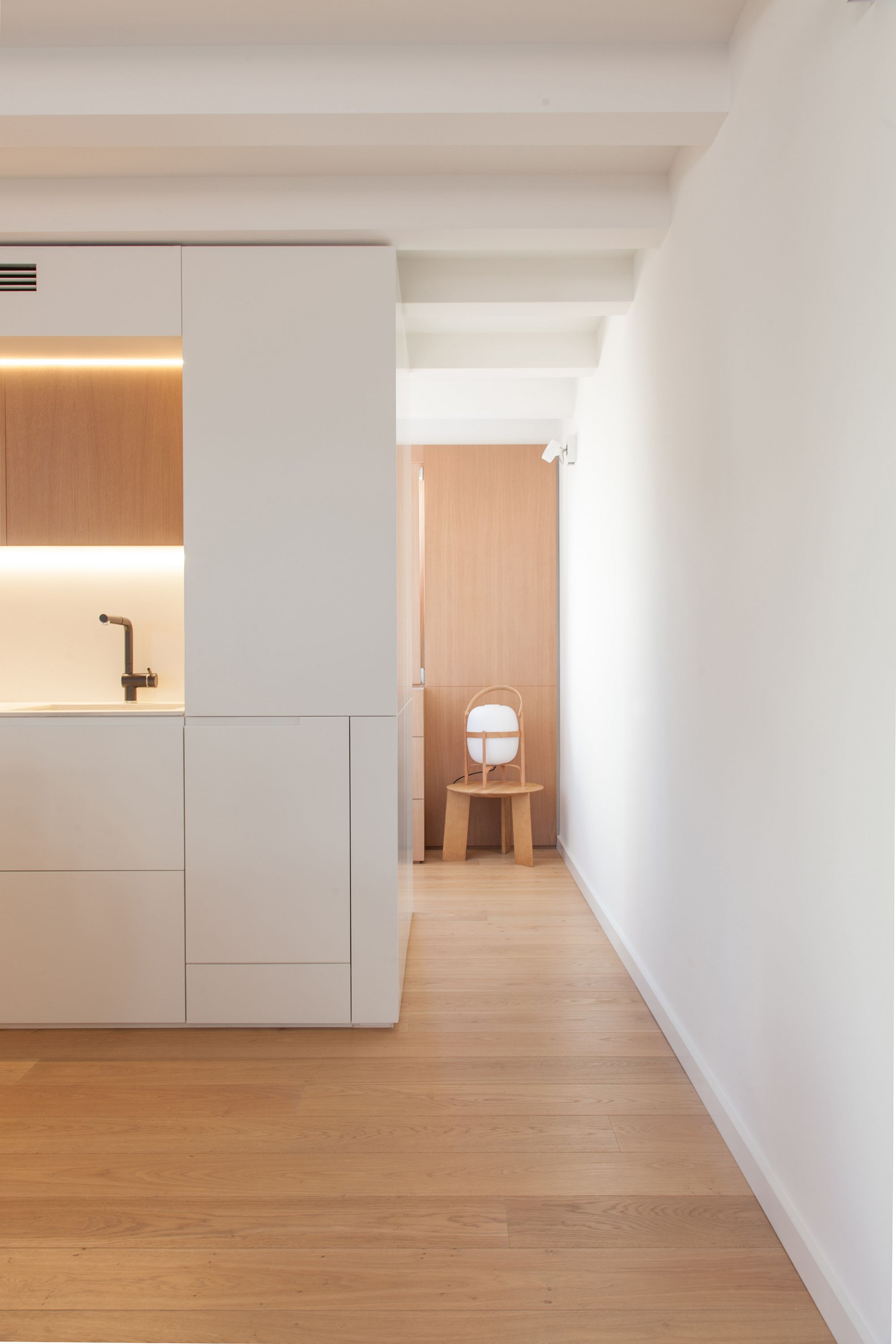 Hidden behind the custom units are cabinets that serve different functions