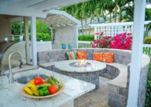 Integrating-the-outdoor-kitchen-with-the-fire-pit-and-the-seating-around-it-217x155