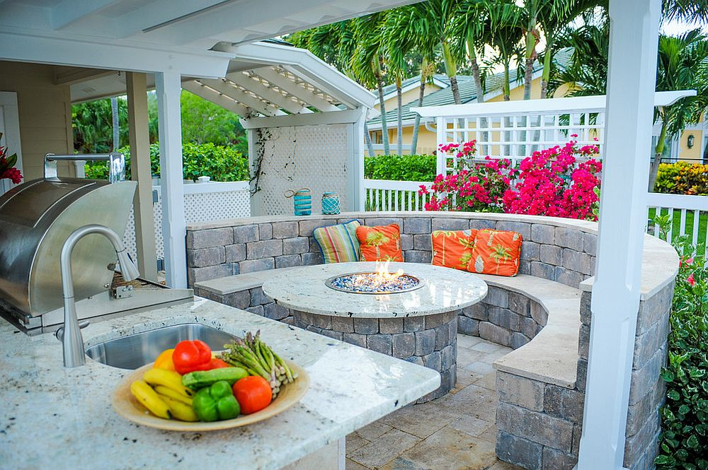 Integrating the outdoor kitchen with the fire pit and the seating around it