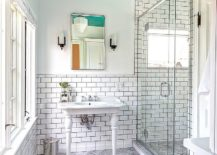 It-is-the-blue-ceiling-that-brings-color-to-this-neutral-bathroom-in-white-217x155