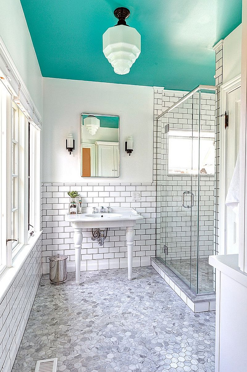 It is the blue ceiling that brings color to this neutral bathroom in white