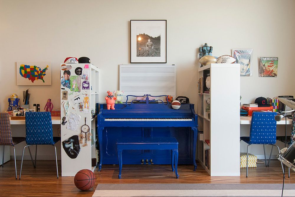 Kids' room with multiple homeworkstations and a music area