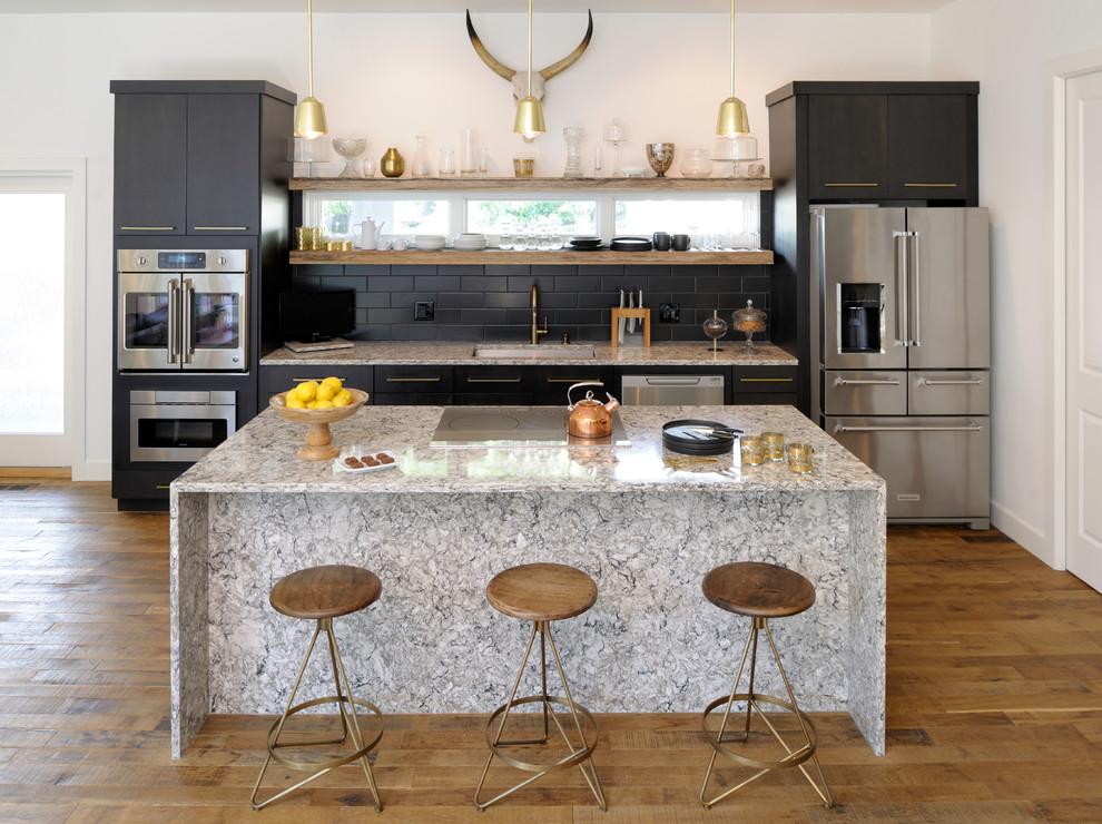 Large-black-tiles-for-the-kitchen-backsplash-make-a-big-impact
