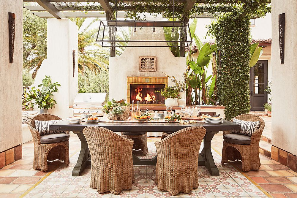 Let wooden beams and natural greenery create a lovely covering for your patio