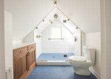 Light-filled-transitional-bathroom-in-white-with-blue-penny-tiled-flooring-217x155
