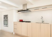 Lightness-and-space-savvy-design-of-the-kitchen-in-white-and-wood-217x155