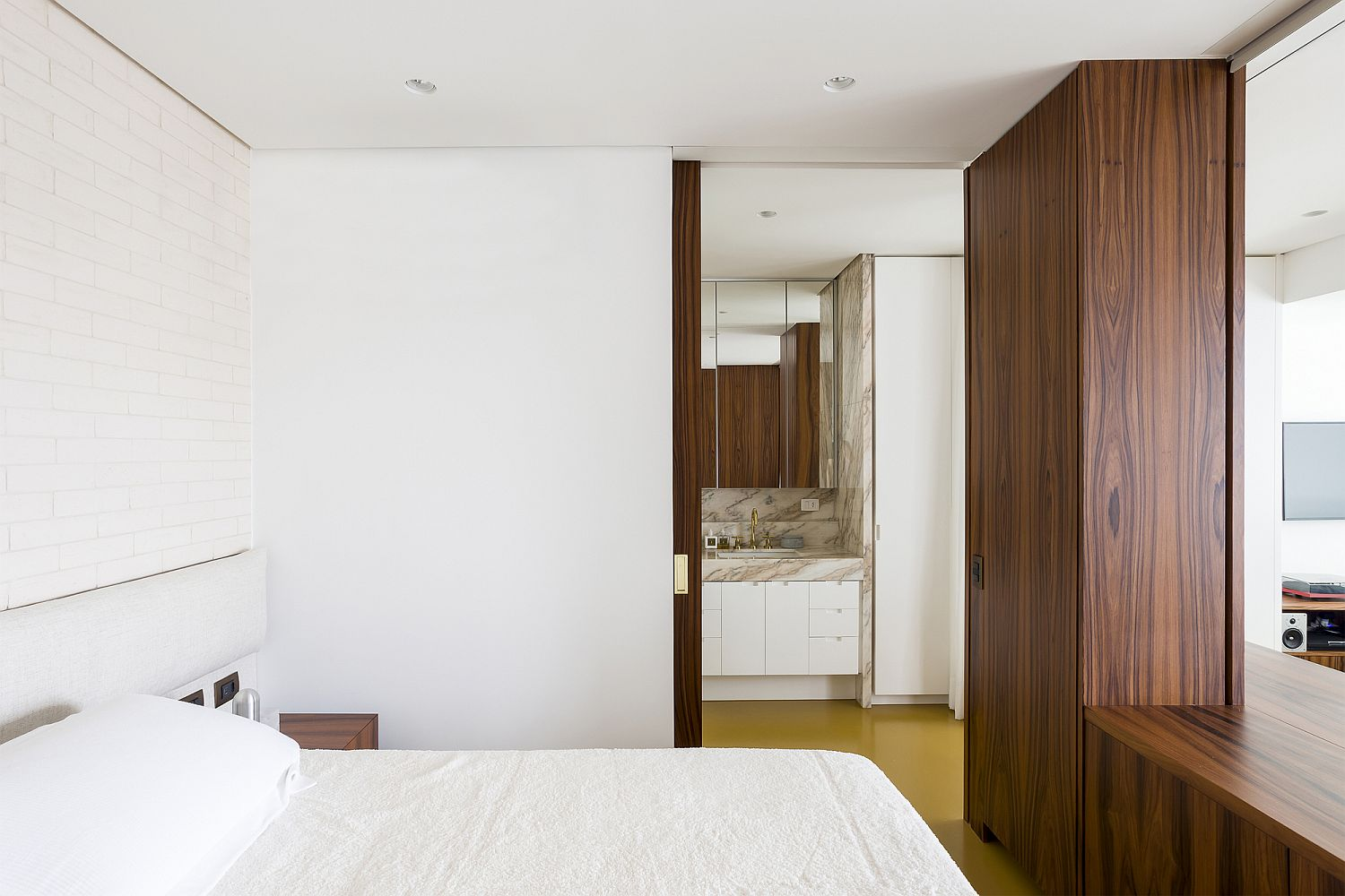 Look inside the custom bedroom and bathroom of the apartment