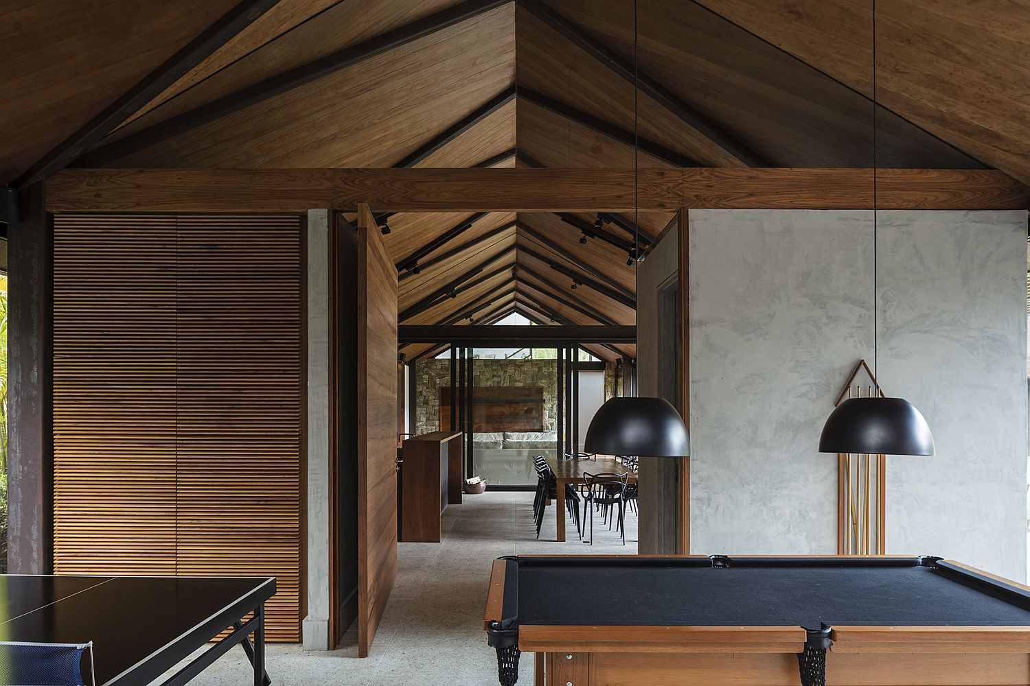 Lovely-blend-of-stone-wood-and-glass-inside-the-contemporary-Brazilian-home