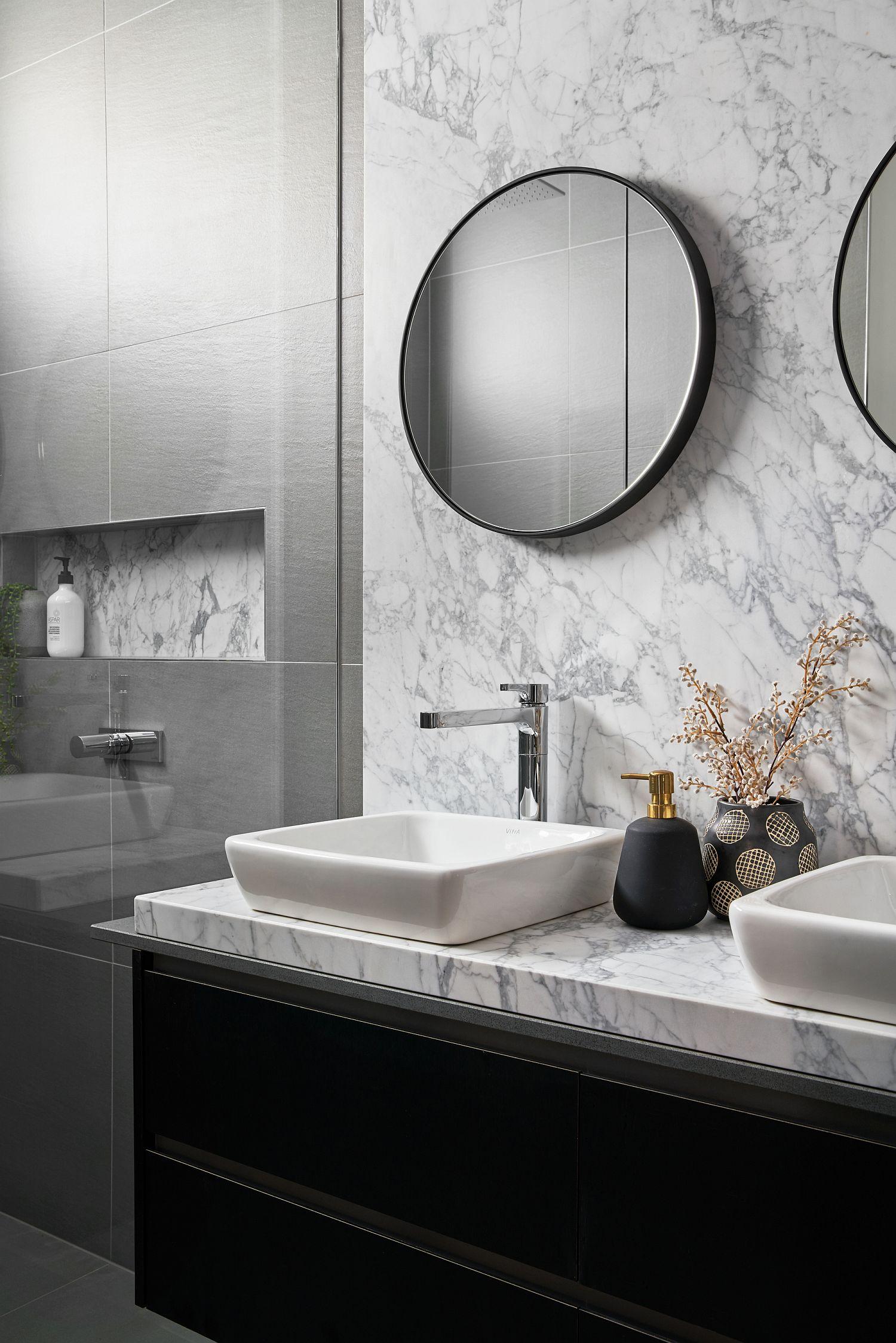 Marble covered bathroom vanity in black