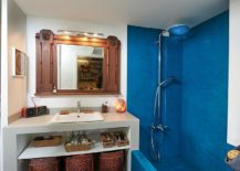 Mediterranean-style-bathroom-with-blue-section-and-shower-area-217x155