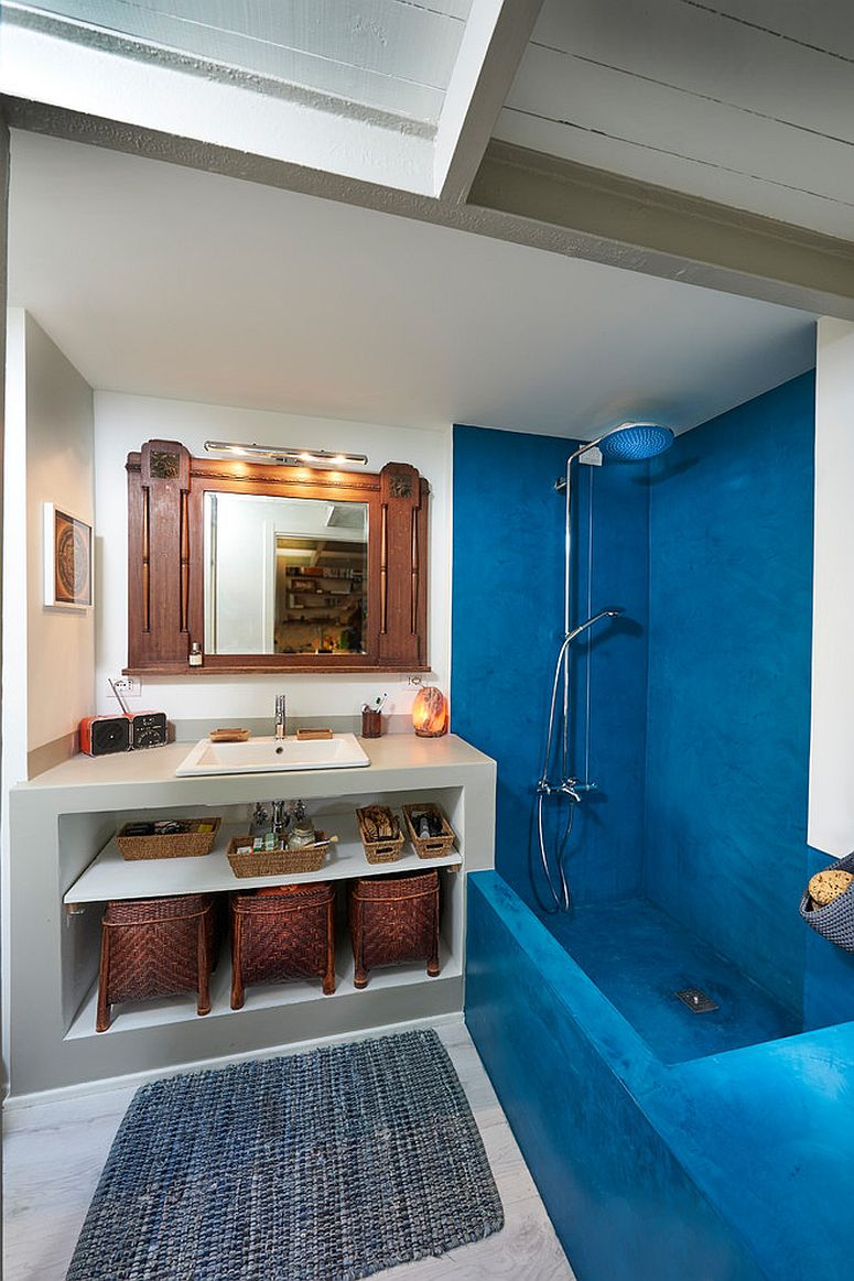 Mediterranean style bathroom with blue section and shower area
