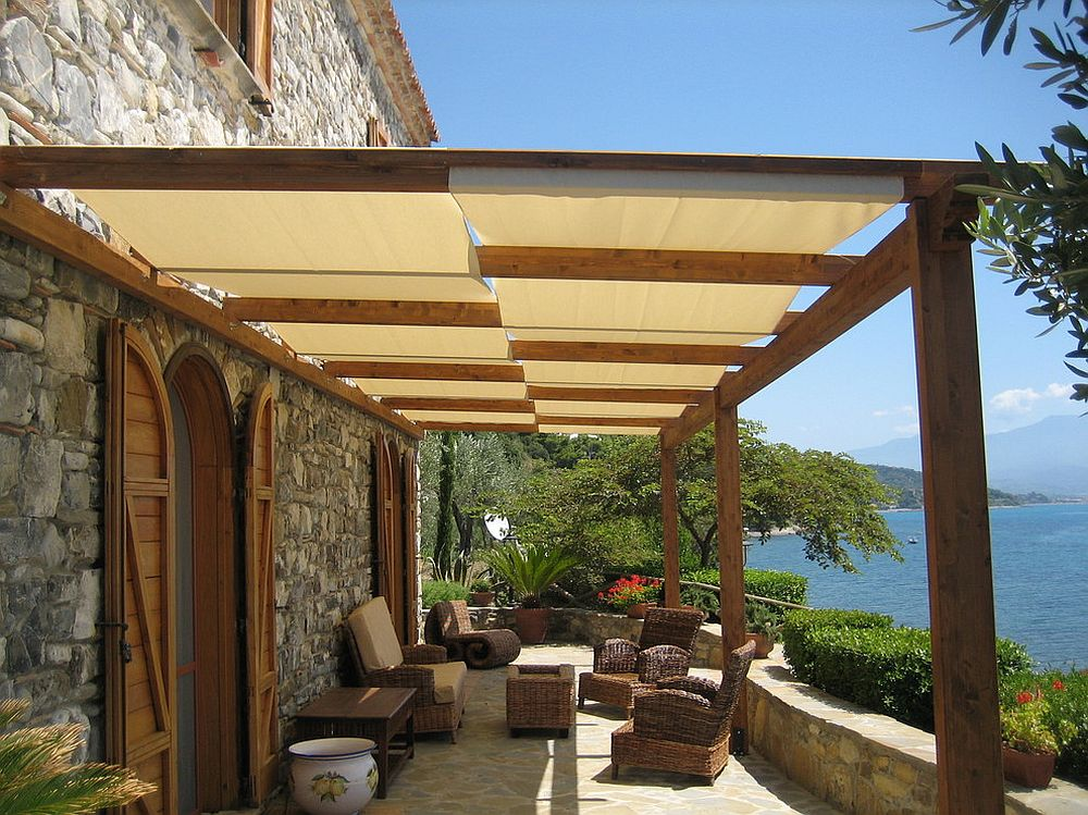 Mediterranean style deck with shade with a view of the ocean