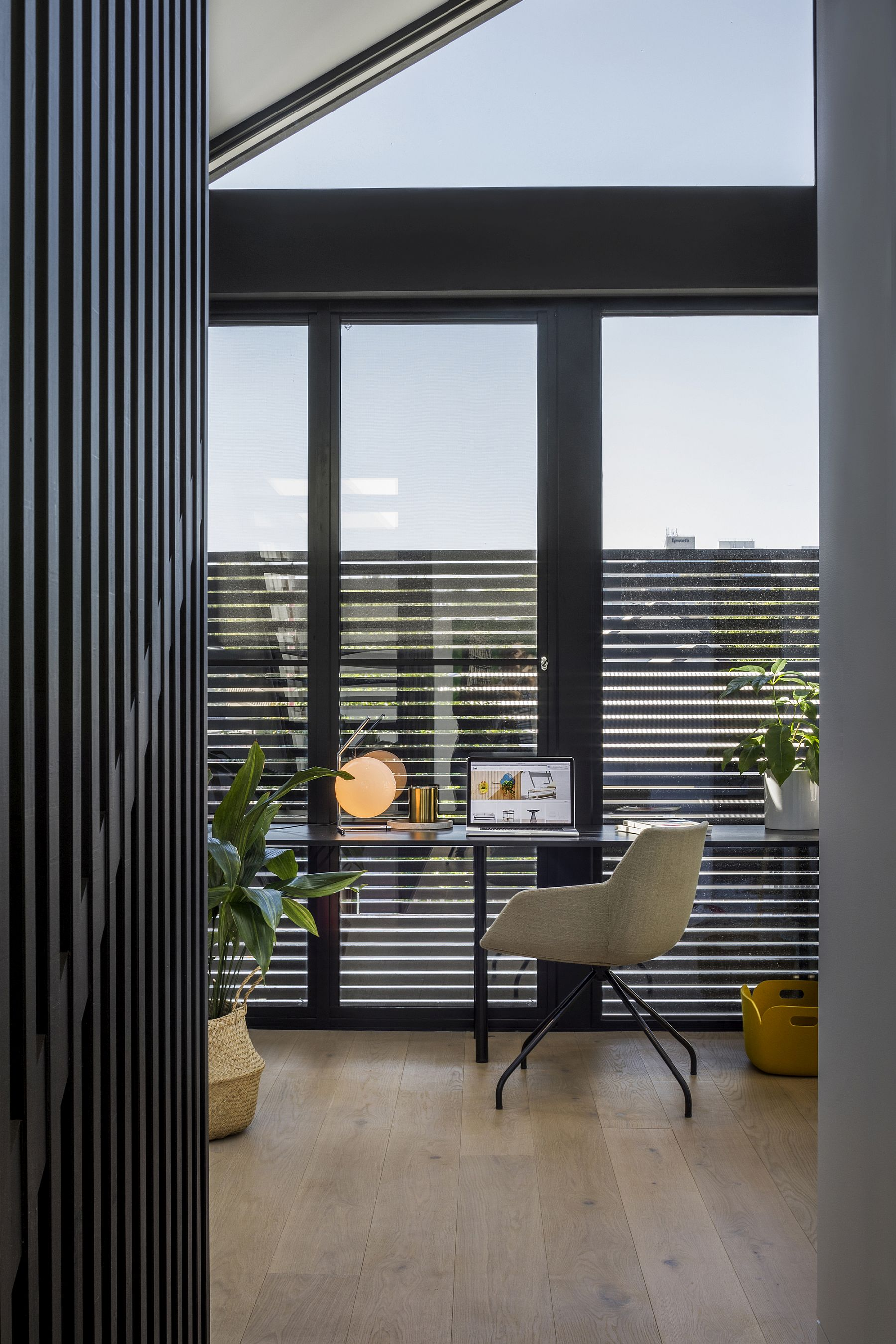Minimal black and white interior of the T2 residence