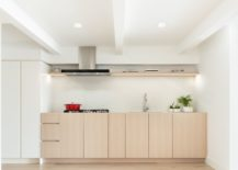 Minimal-kitchen-in-wood-and-white-is-a-hot-trend-in-the-design-world-217x155