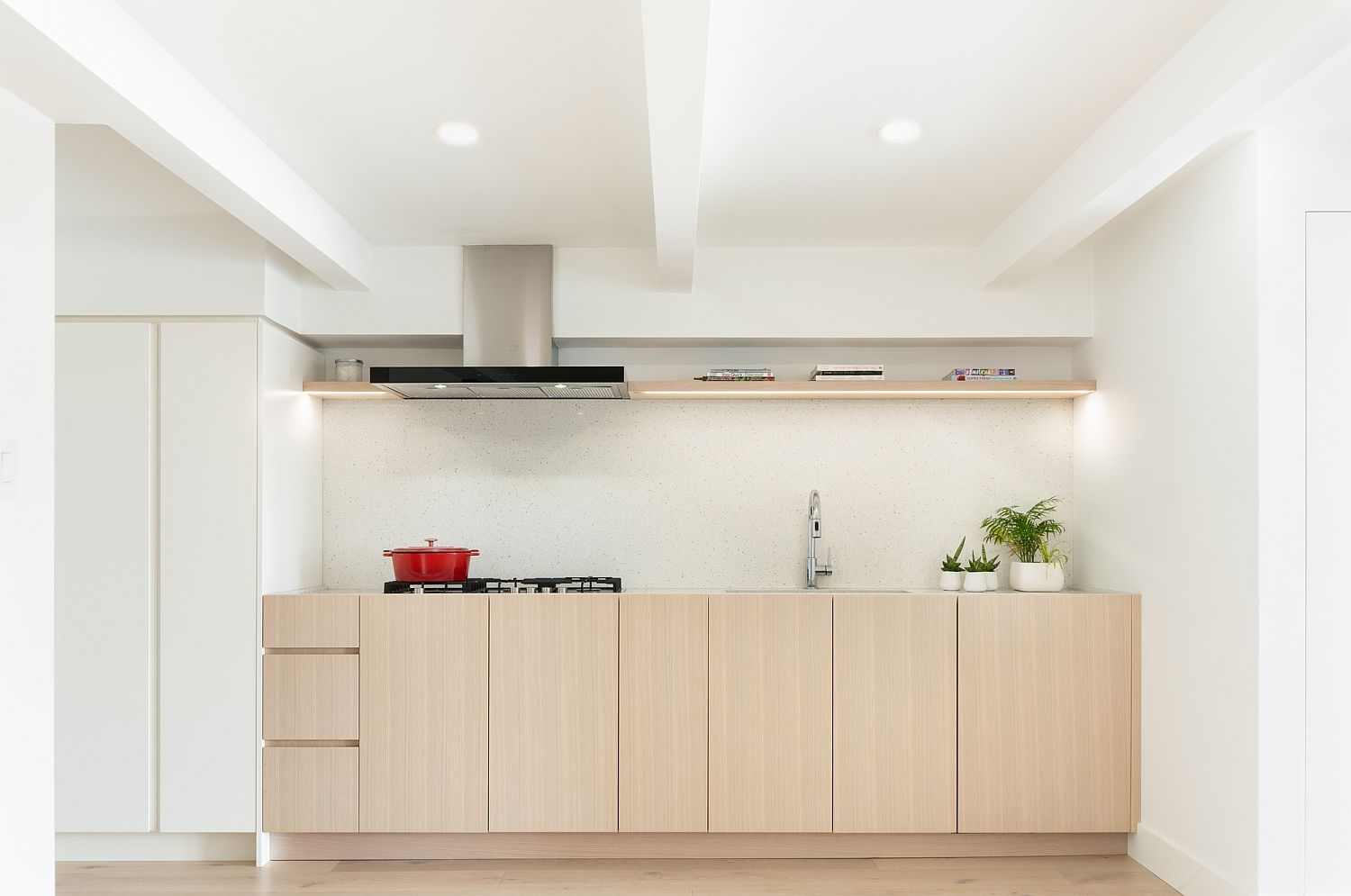 Minimal kitchen in wood and white is a hot trend in the design world