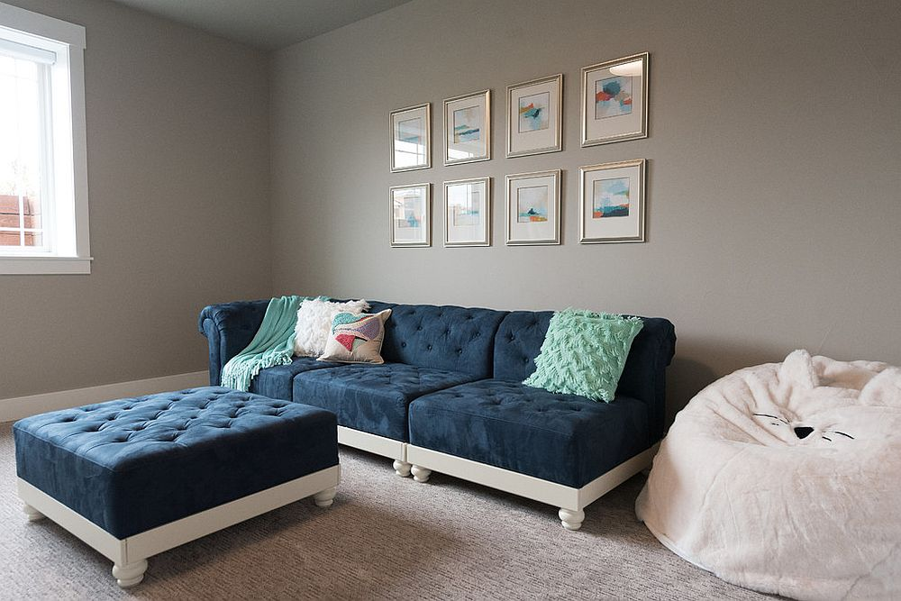 Navy blue coupled with white in the small, gray family room