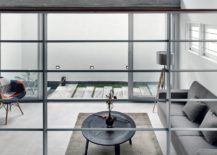 Open-to-sky-courtyard-next-to-the-living-room-inside-House-S-217x155