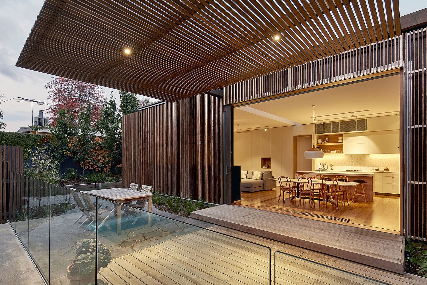Operable timber screens help control the degree of sunlight entering the home over various seasons
