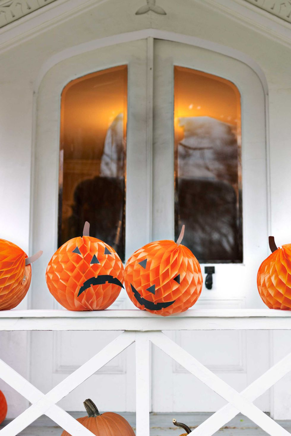Orange tissue paper replaces pumpkins in this cool Halloween decorating idea