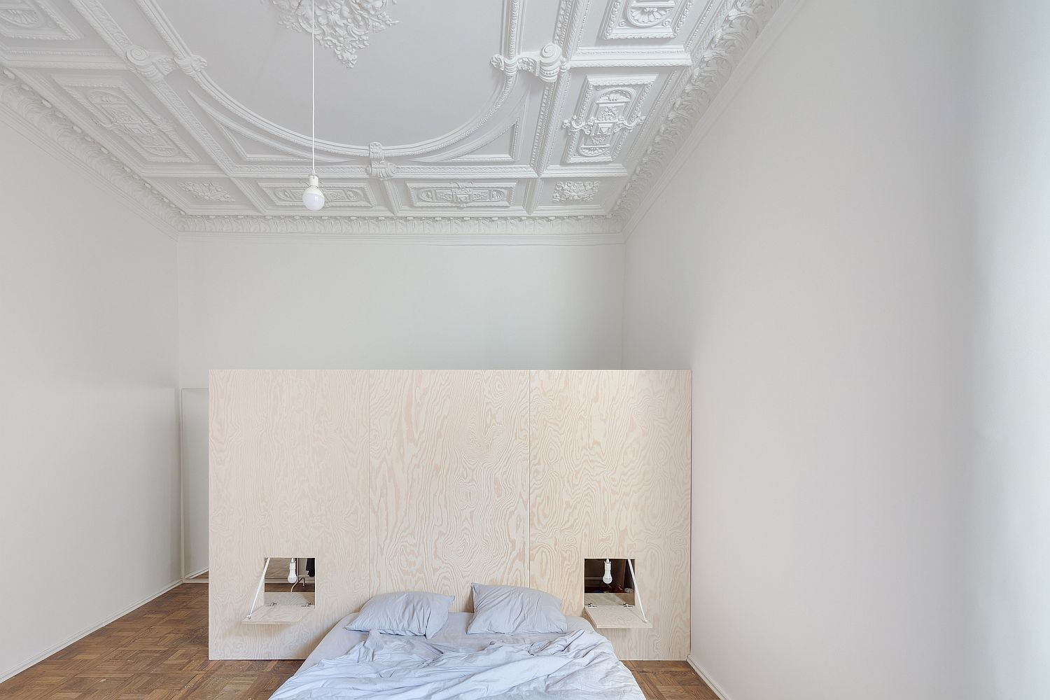 Ornate-ceiling-blends-into-the-modern-minimal-backdrop-of-white-with-ease