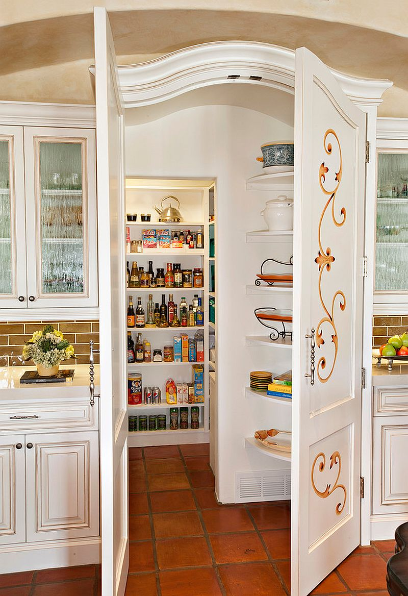 spanish style pantry doors with baroque design