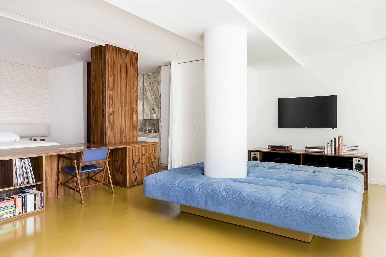 Plush bright sofa in blue in the living room