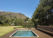Pool-with-Hijau-stone-and-wooden-deck-around-it-217x155
