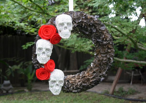 Skulls and sparkle shape this dark Halloween themed DIY wreath