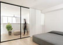 Sliding-glass-doors-and-white-drapes-for-the-upper-level-bedroom-217x155