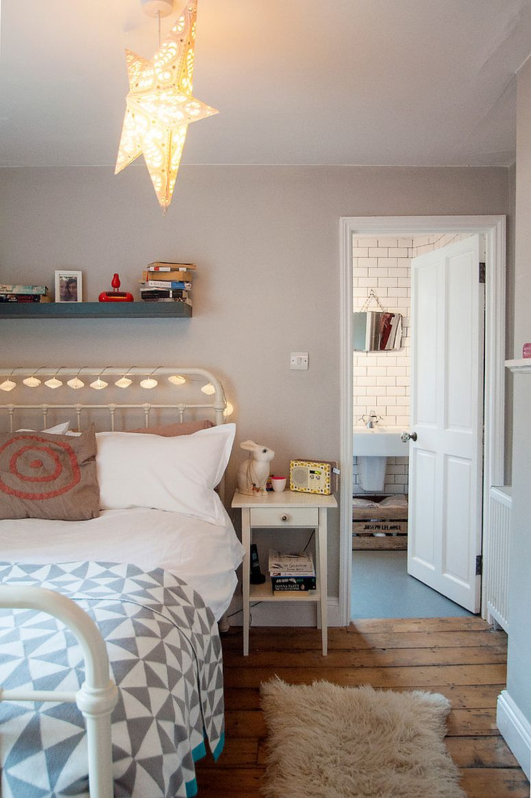 Smartly decorated bed frame using string lights in the eclectic bedroom