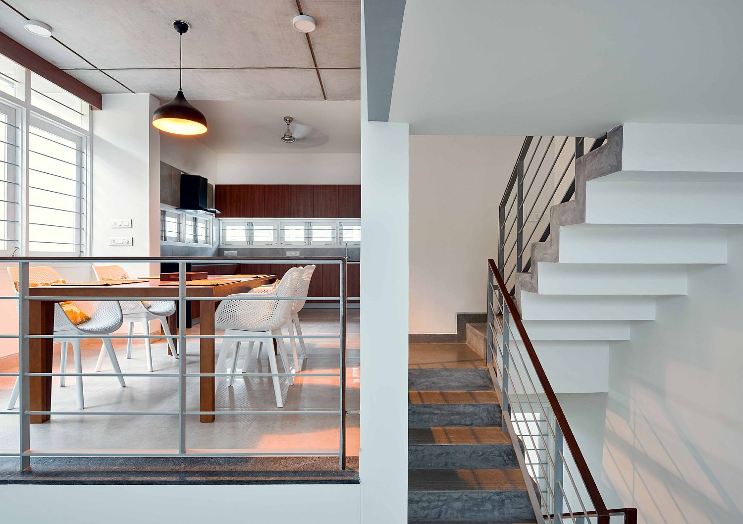 Split level dining area and kitchen of the House S