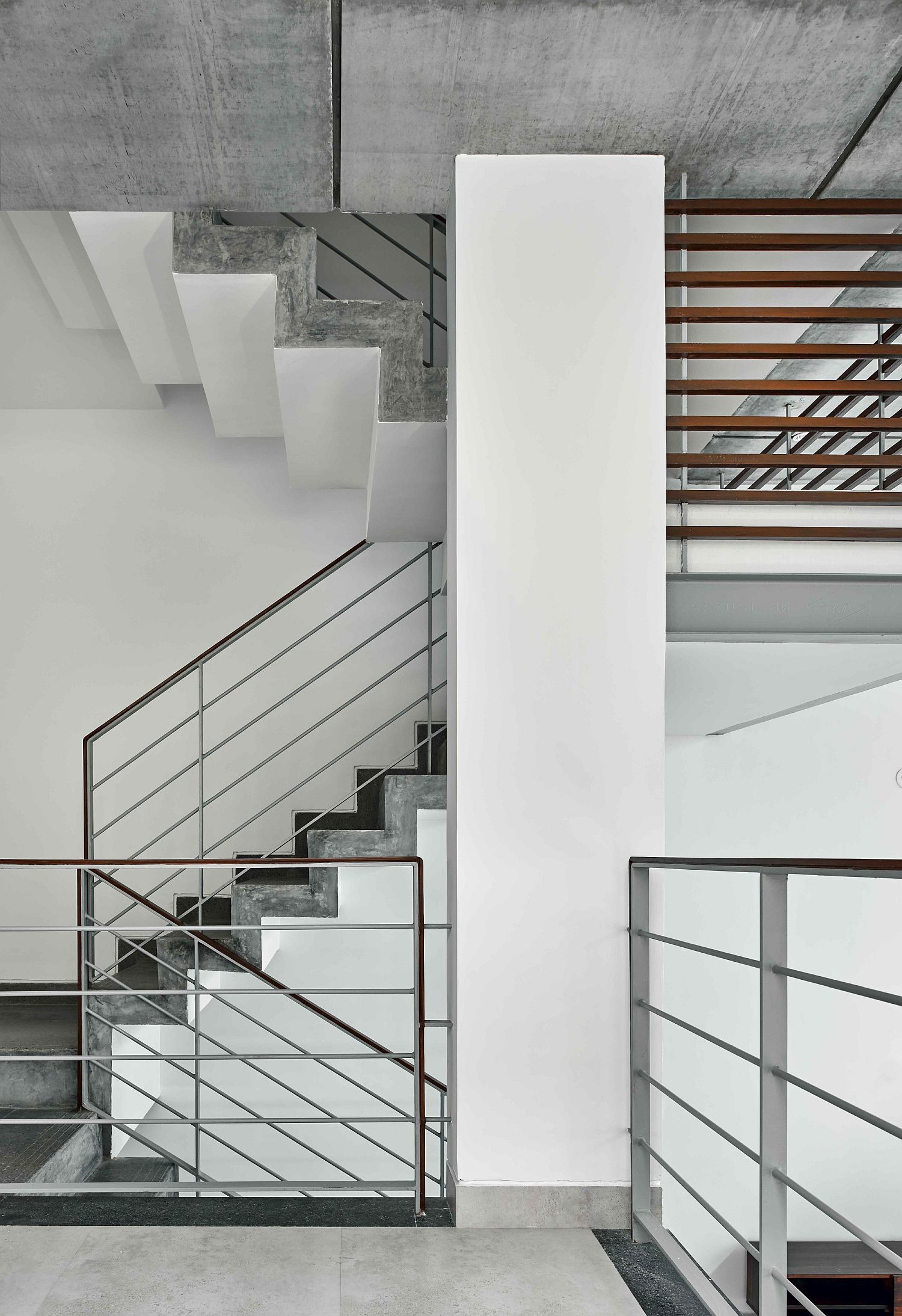 Staircase connecting the multiple levels of modern home in Bangalore
