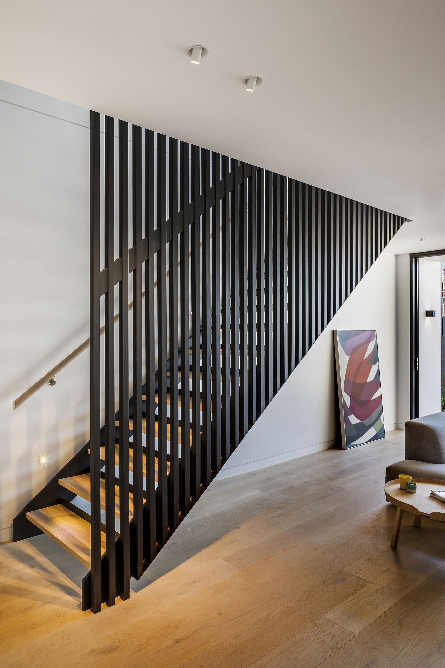 Staircase feels both modern and organic inside the house