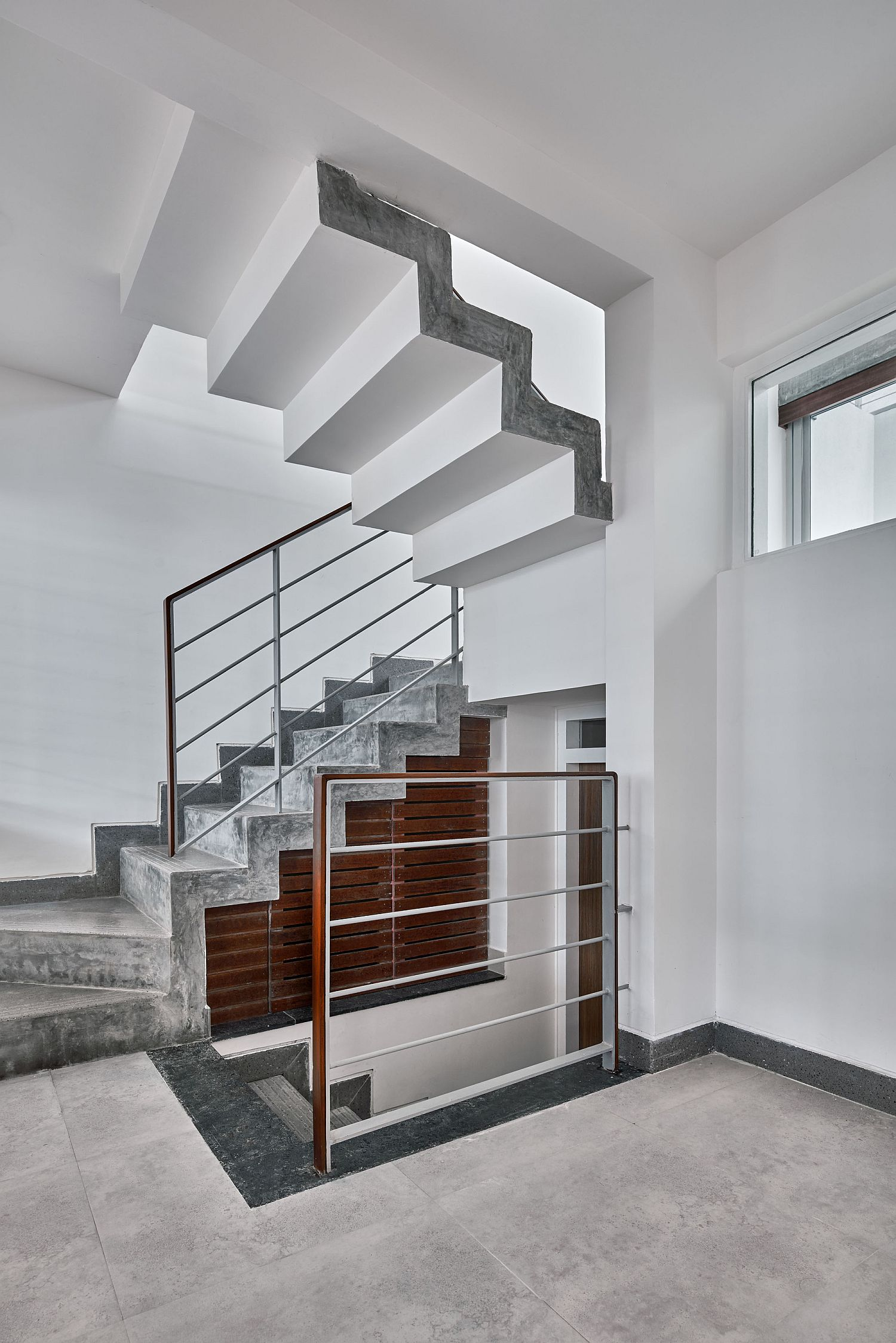 Staircase in concrete fits in perfectly with the neutral color palette of the home