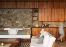 Stone-and-wood-open-living-area-that-flows-into-the-deck-217x155