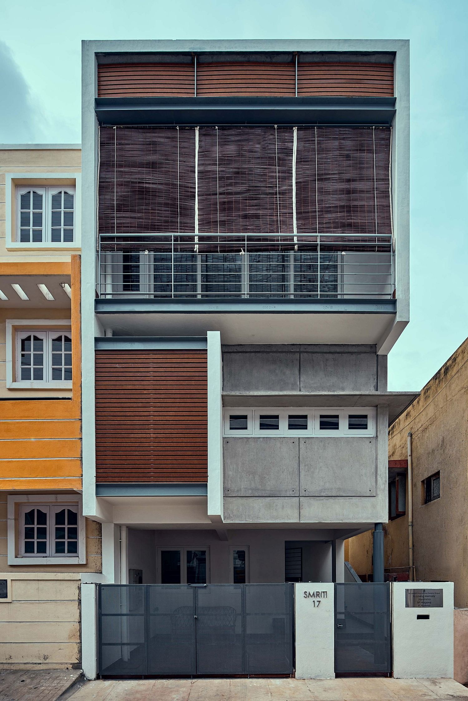 Street facade of House S with wooden slats