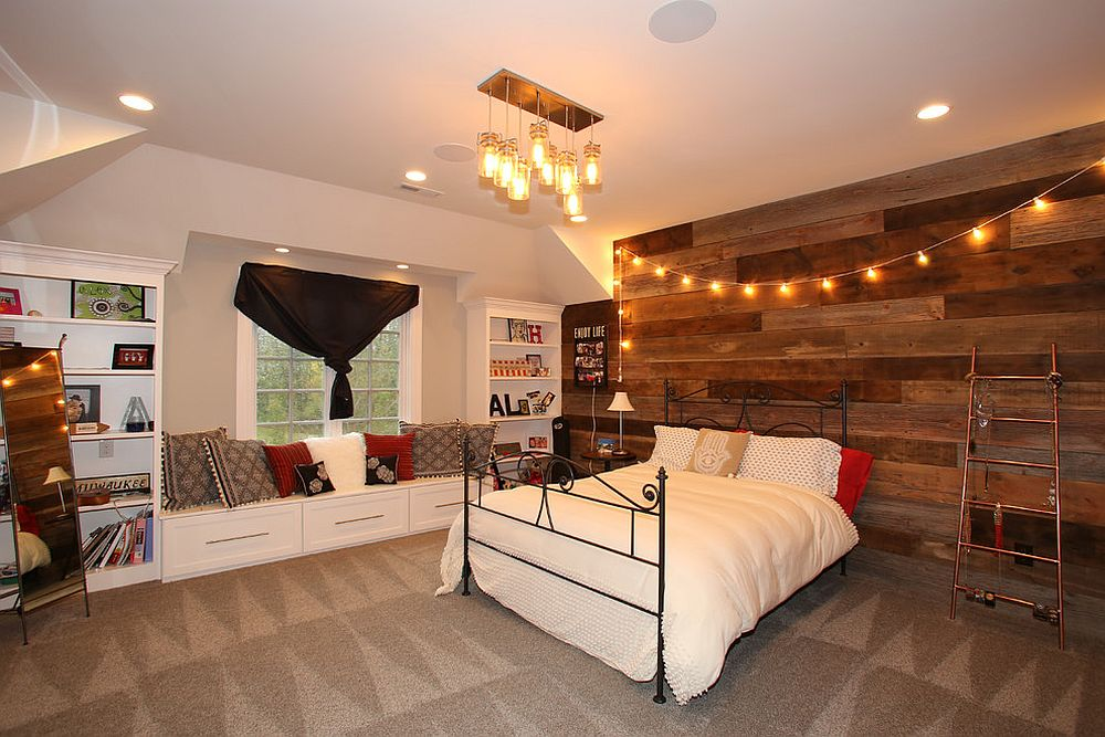 String lights bring warmth to the rustic bedroom with wooden accent wall