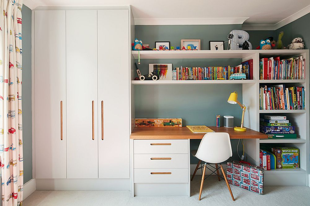 Study in the contemporary kids' room with ample storage and shelf space