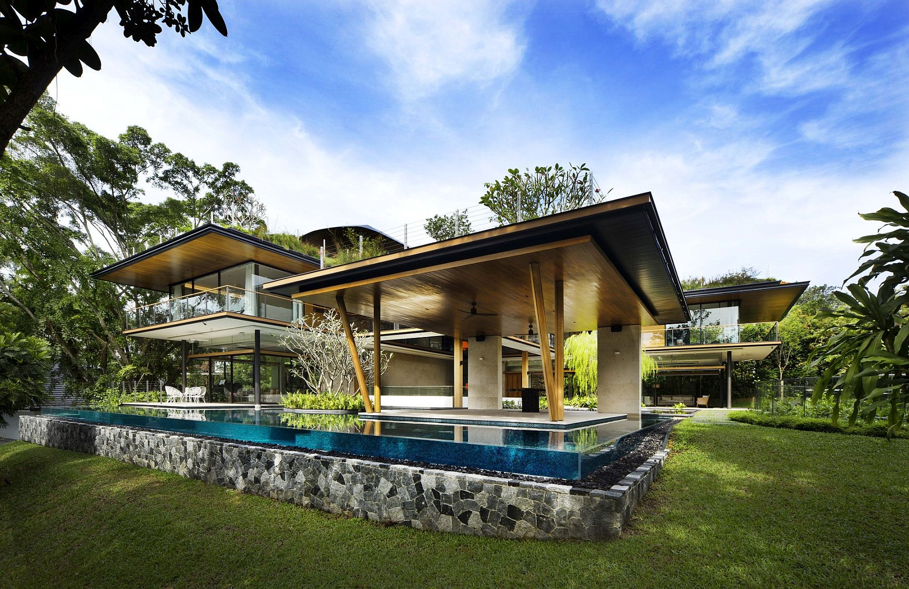 Stunning contemporary house with plenty of greenery and a natural pond and pool