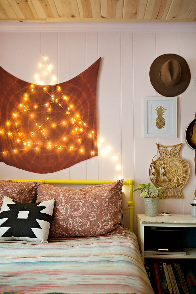 Stunningly beautiful eclectic bohemian bedroom with string lighting in the backdrop