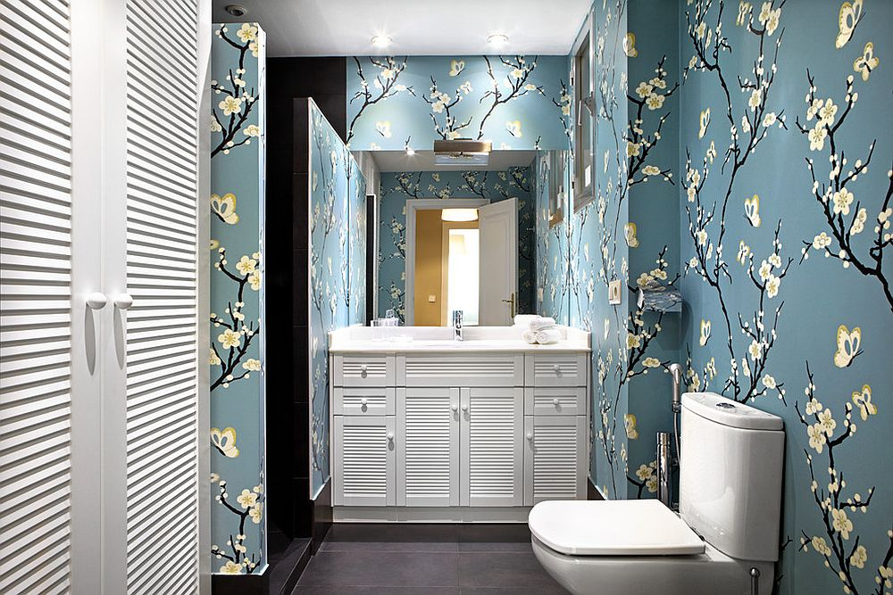 Transitional bathroom clad in lovely grayish-blue wallpaper with floral pattern