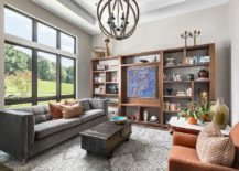 Transitional-living-room-with-custom-wooden-shelving-that-acts-as-a-lovely-display-217x155