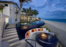Tropical-pool-with-fire-pit-at-its-heart-next-to-the-beach-and-sunken-seating-217x155